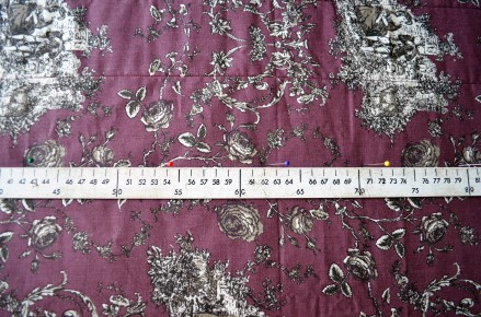 Attaching the main fabric to the wadding by quilting in straight lines.