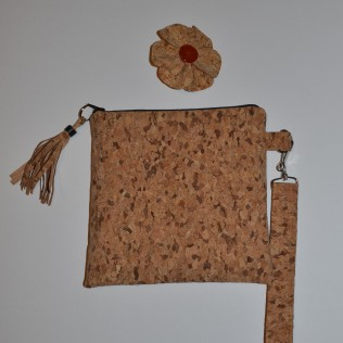 A lovely cork bag with trimmings.